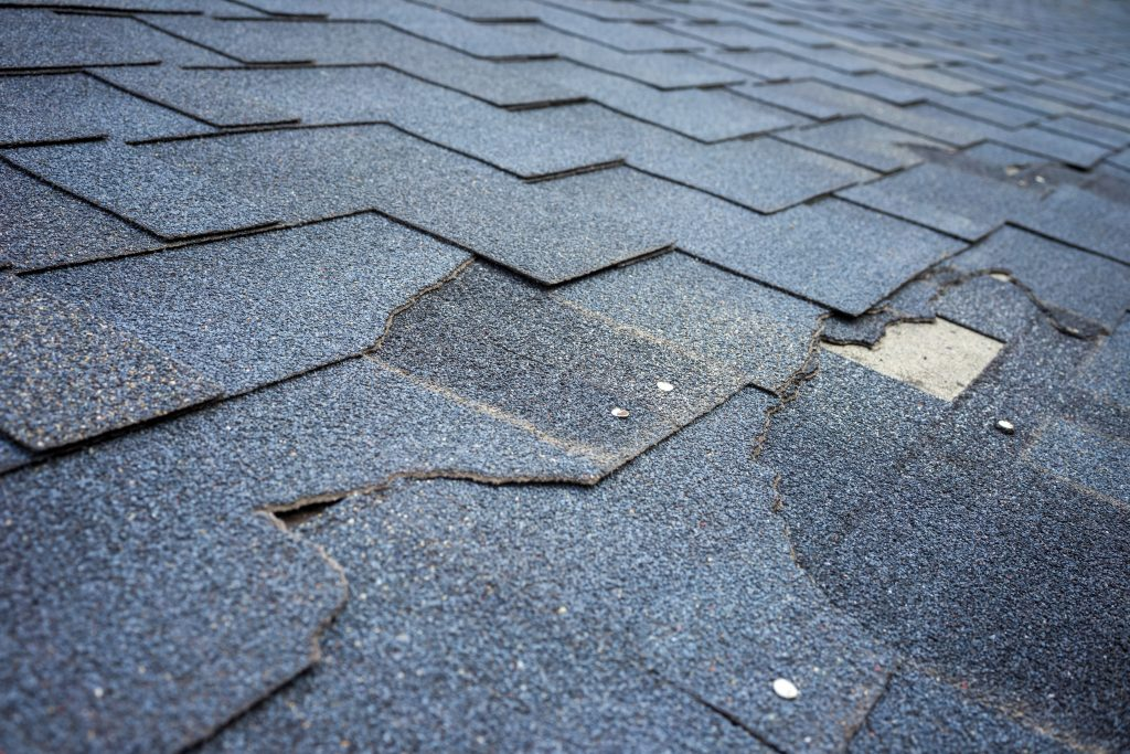 how often should you replace your roof: damaged shingles