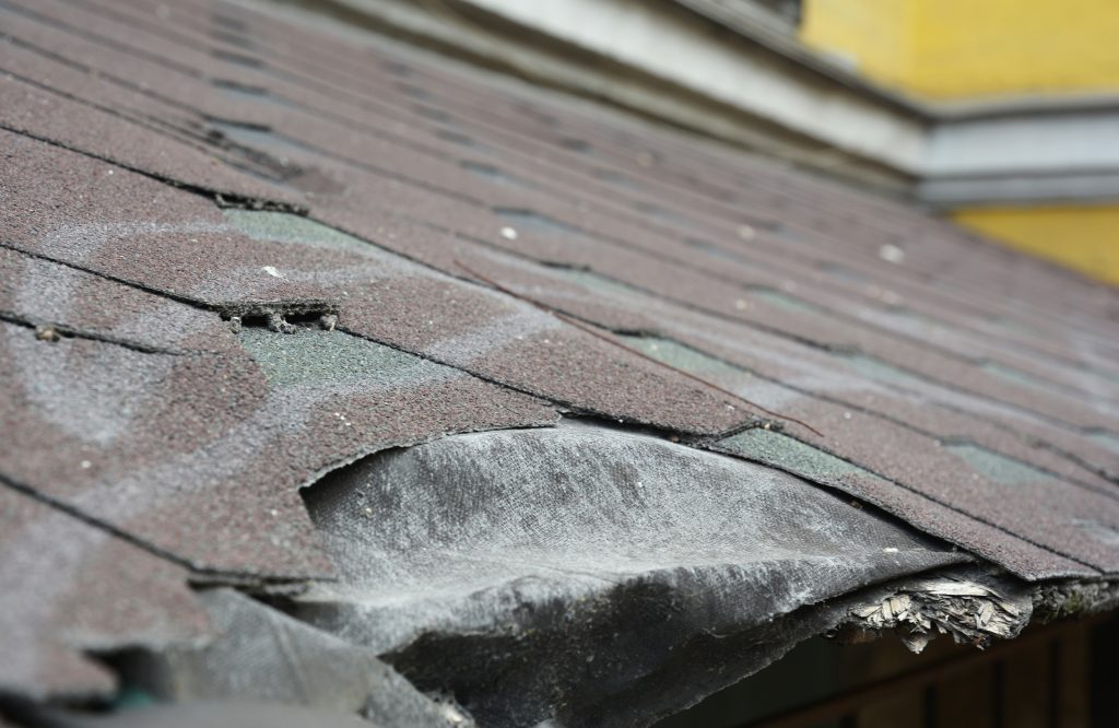 discolored and warped shingles